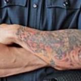 Полицейским Сорренто запретят делать тату и пирсинг